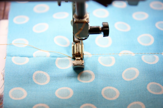 Sew back and forth a few times, to secure the end of the zipper section on the fabric