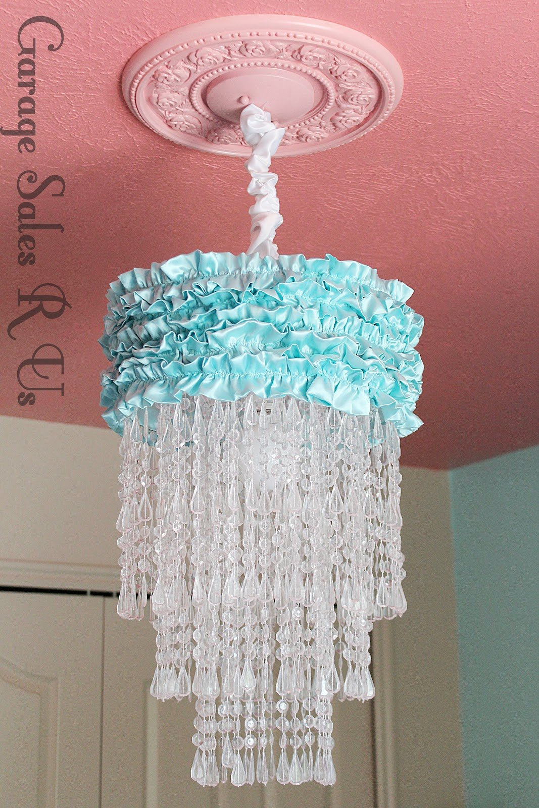 25 diy chandelier ideas make it and love it bead and ruffle chandelier by garage sales r us 5 arubaitofo Gallery