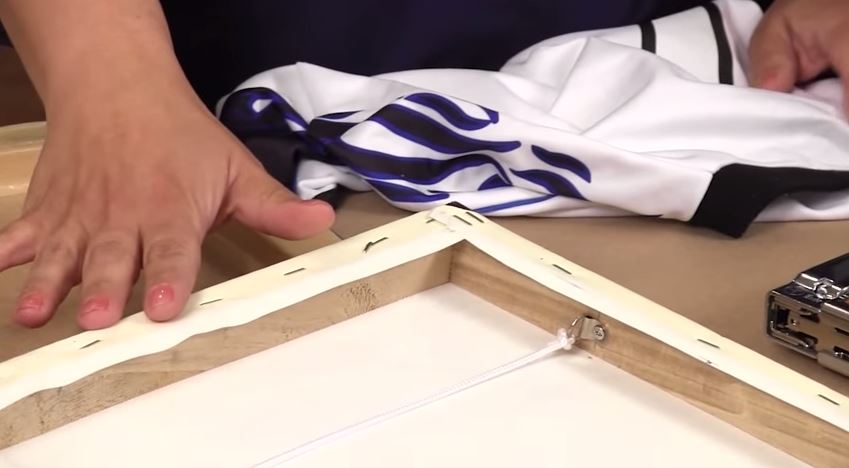 Make Wall Art With A Jersey and Framed Canvas