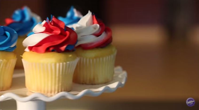 Red, white, and blue swirled frosting cupcakes