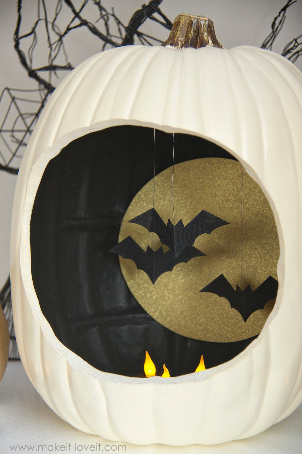 Autumn decor: pumpkins with hanging and flying bats