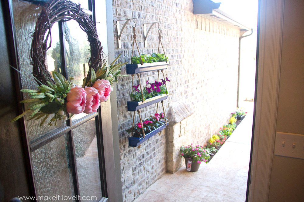 DIY Hanging Rain Gutter Planters | via Make It and Love It