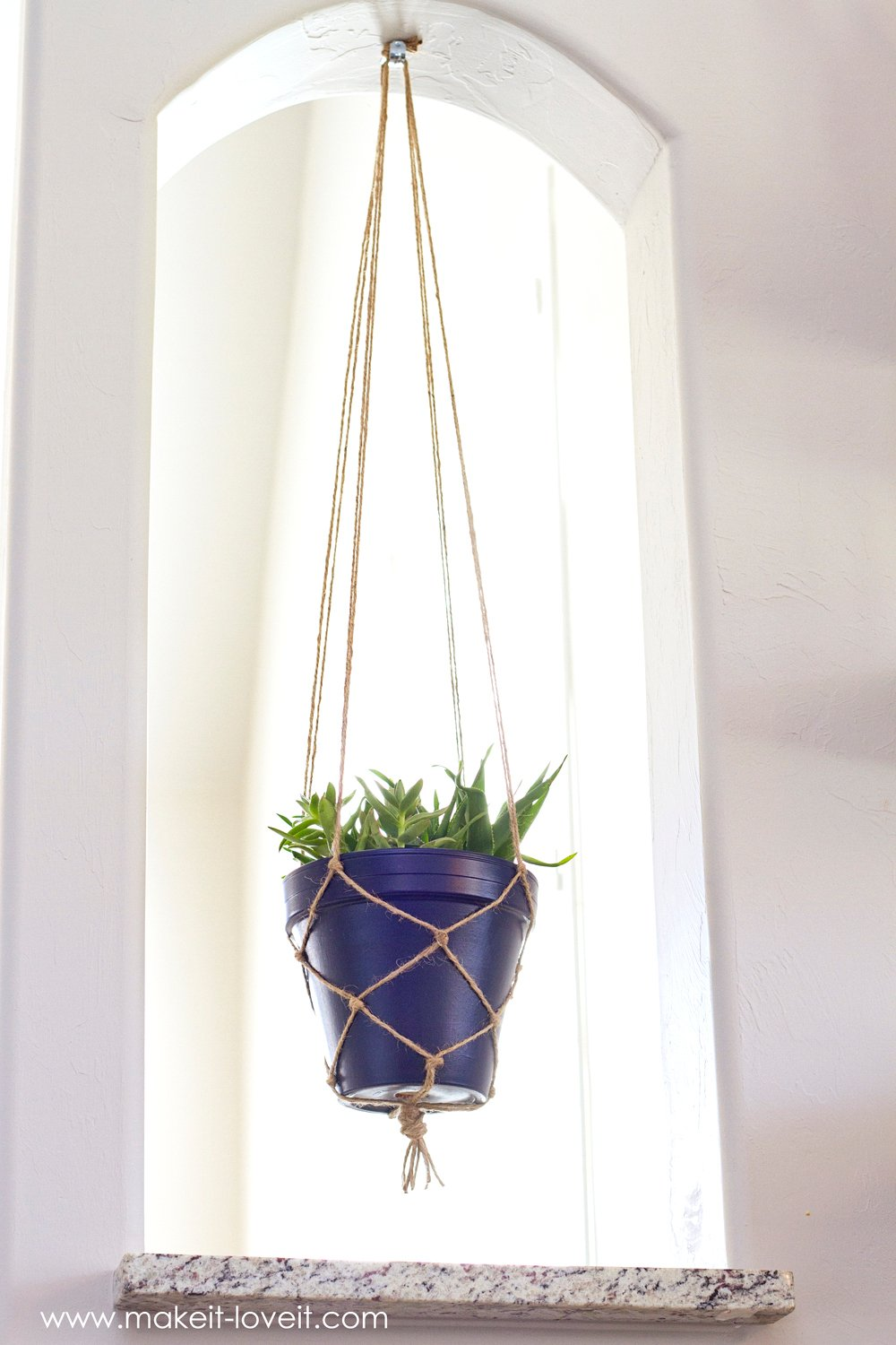How to make a SIMPLE Rope Plant Hanger....a great way to fill space vertically! | via makeit-loveit.com
